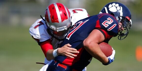 American footballers break down the barrierss